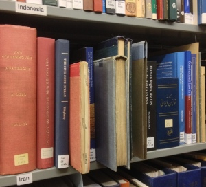 Iranian law books on shelf.